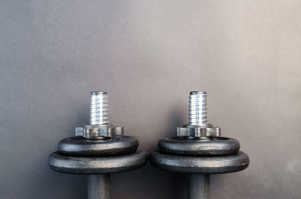 A pair of dumbbell weights