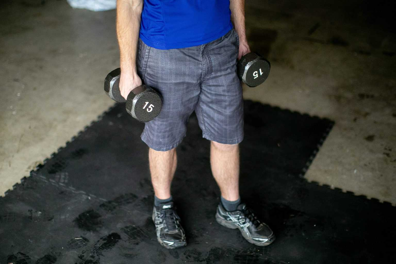 Man holding dumbbells with each hand