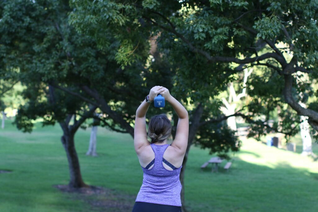 Woman lifting a dumbbell over her head