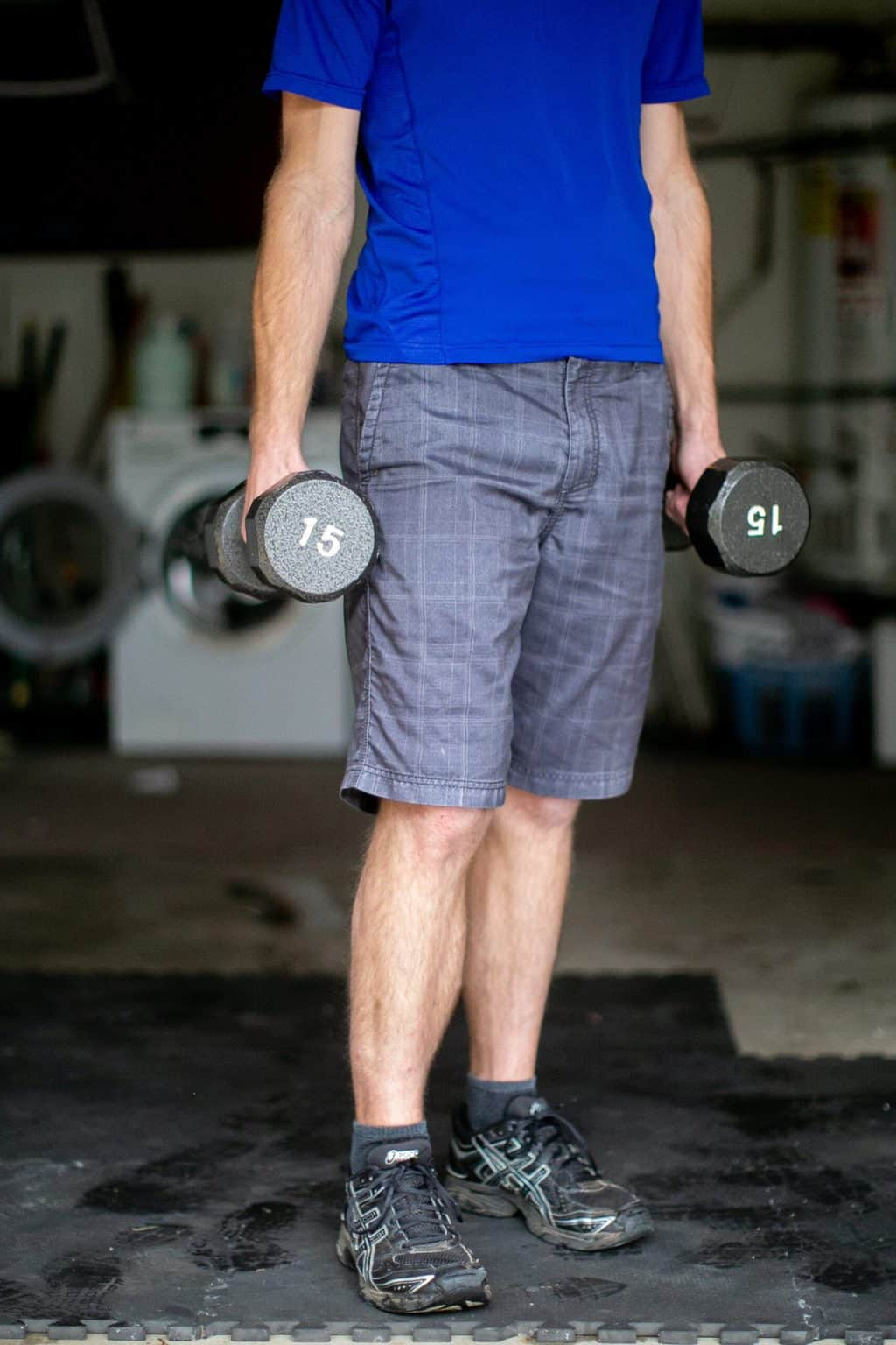 Man carrying 15lb dumbbell weights