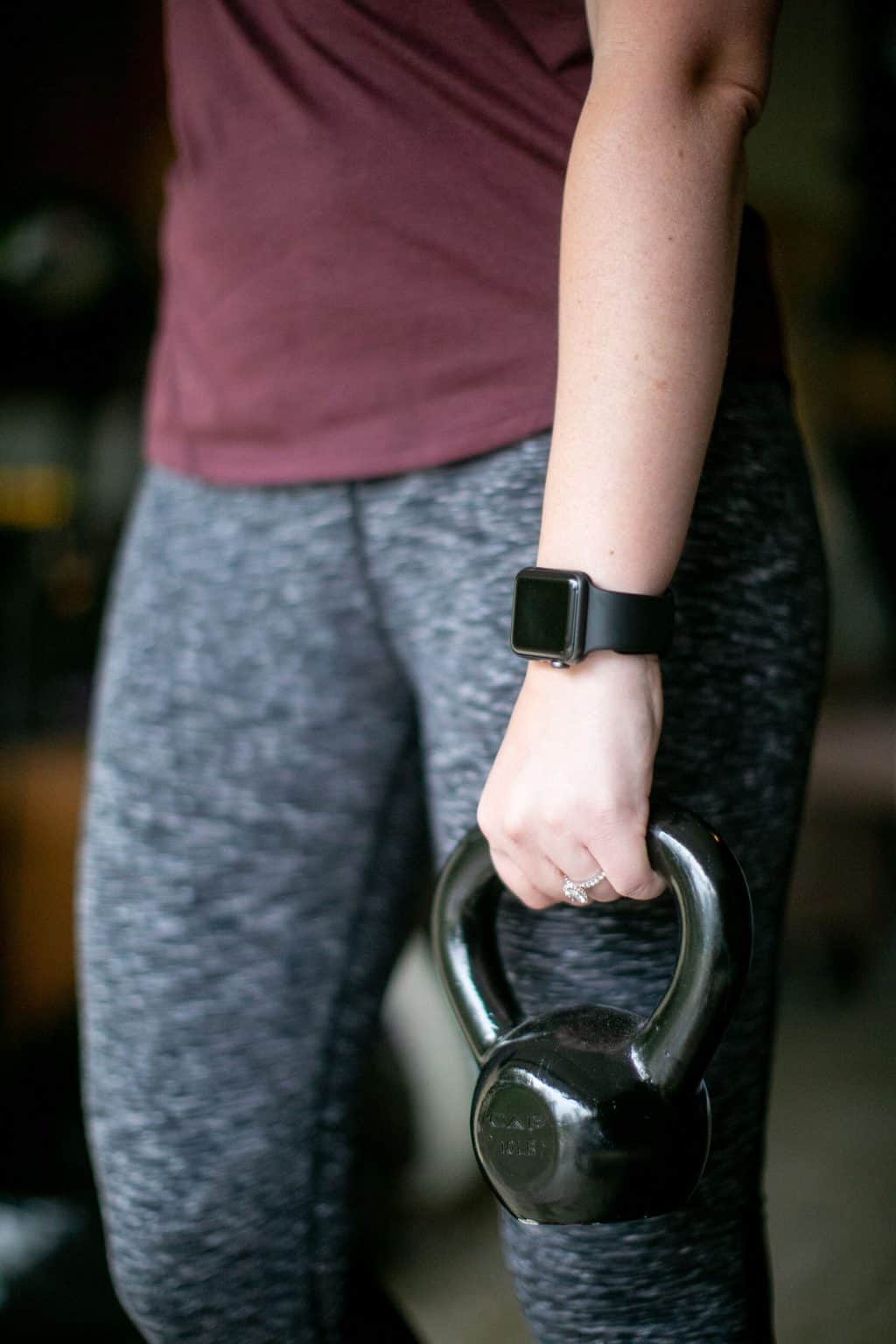 Woman holding a kettlebell with one hand