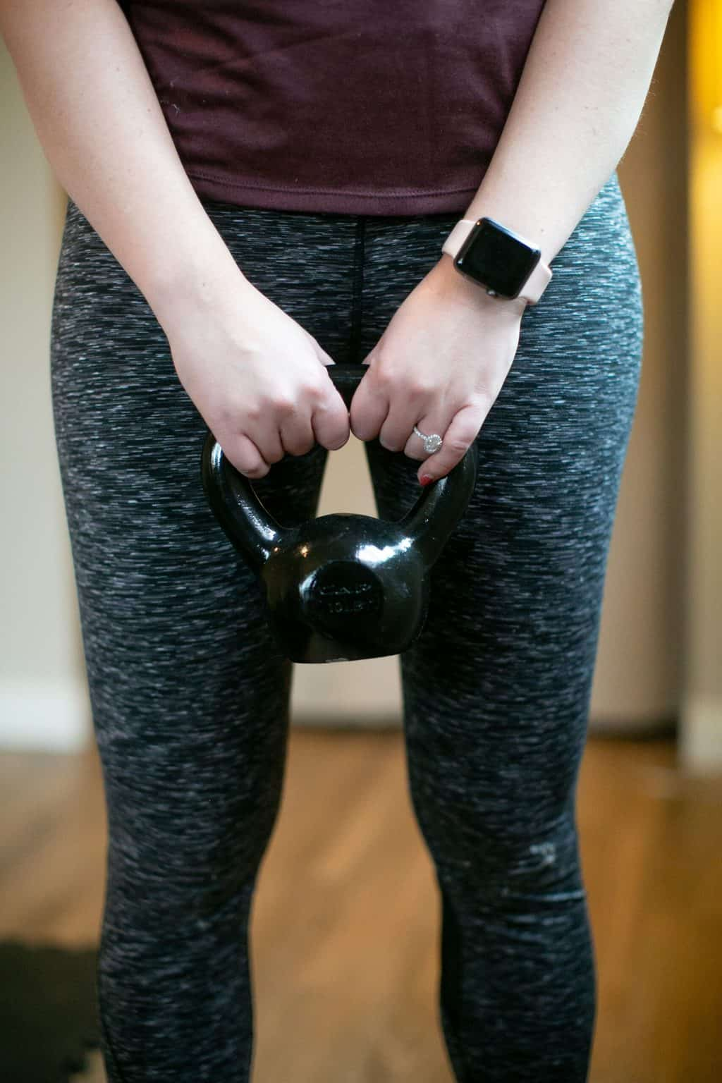 Woman holding a kettlebell with both hands